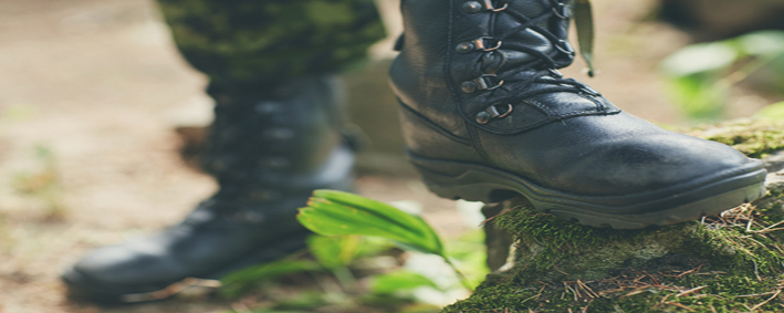 war, hiking, army and people concept - close up of soldier feet