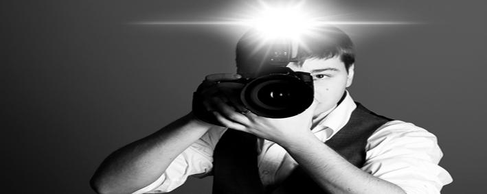 Photographer with camera in studio