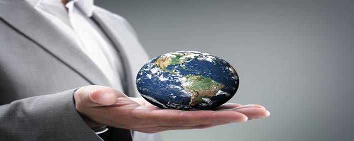 Businessman holding the world in the palm of hands concept for g