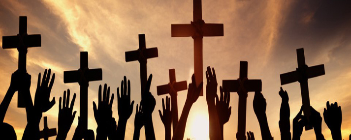 group-of-people-holding-cross-and-praying-in-back-lit-s-960x250.jpg